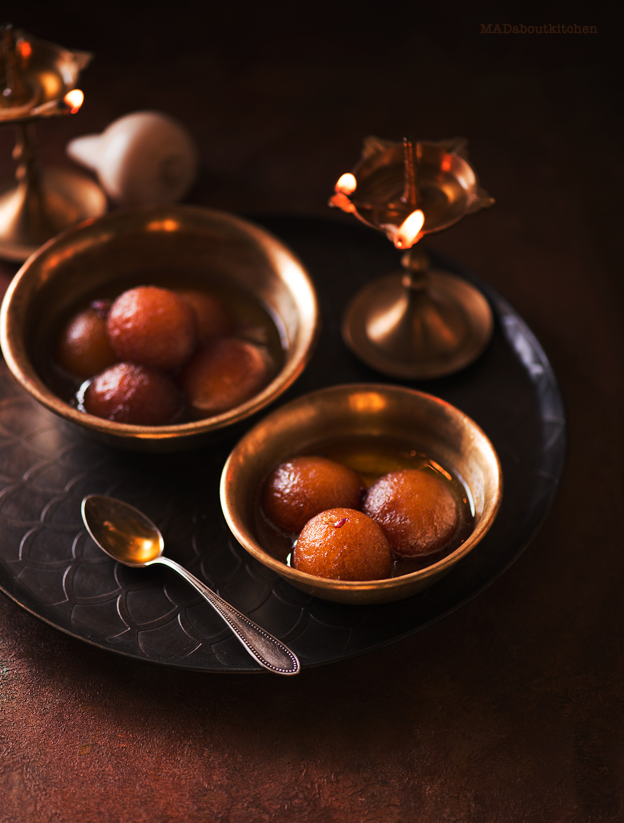 Gulab Jamun, are the most famous Indian Dessert that are deep fried balls made of Khova or reduced milk and soaked in sugar syrup till it is soft and melts in your mouth.