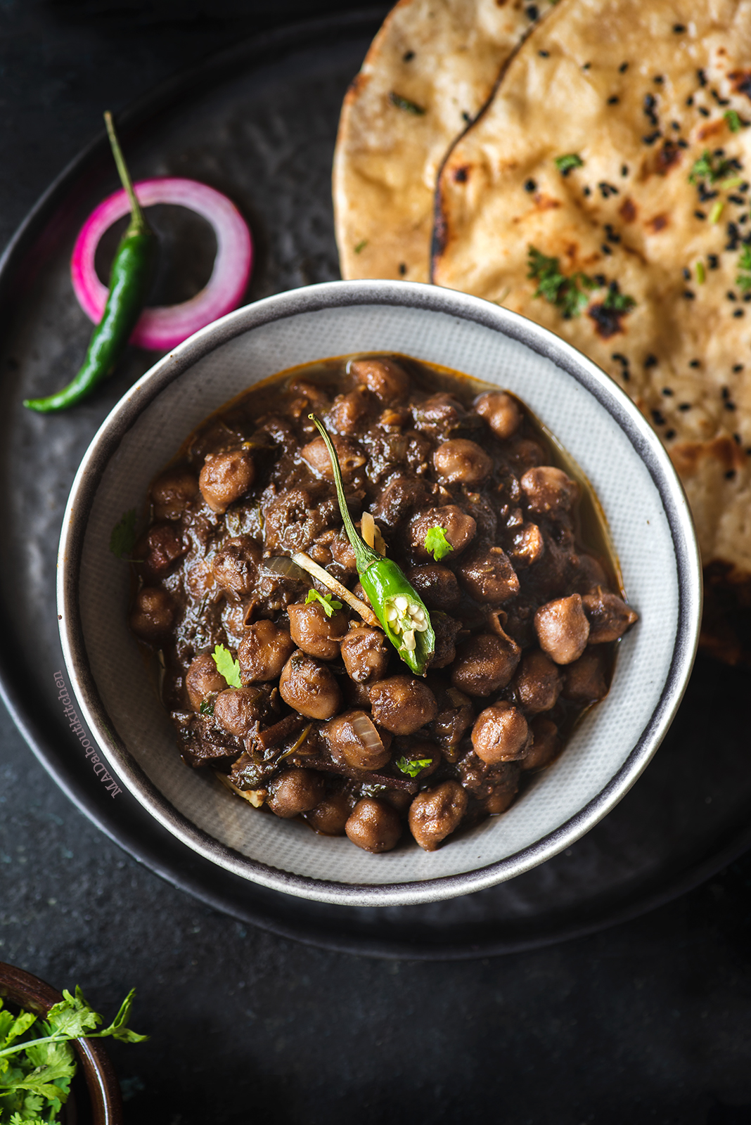Chole is slow cooked chickpea curry in  lots of spices to make a creamy, rich curry which is served with Kulcha, Tandoori roti or Batura.