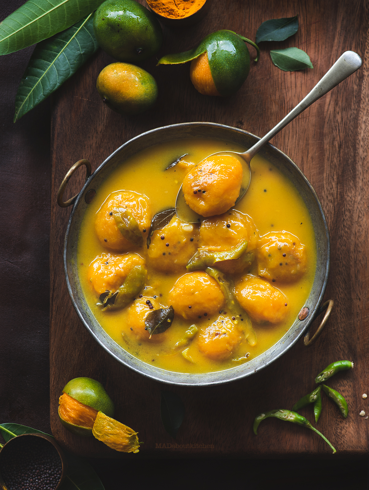 Maavina Hannu Gojju is the mango curry made using the mini mangoes called 'Sakkare guthi' . Maavina Hannu Gojju is a spicy, tangy and sweet mango curry.