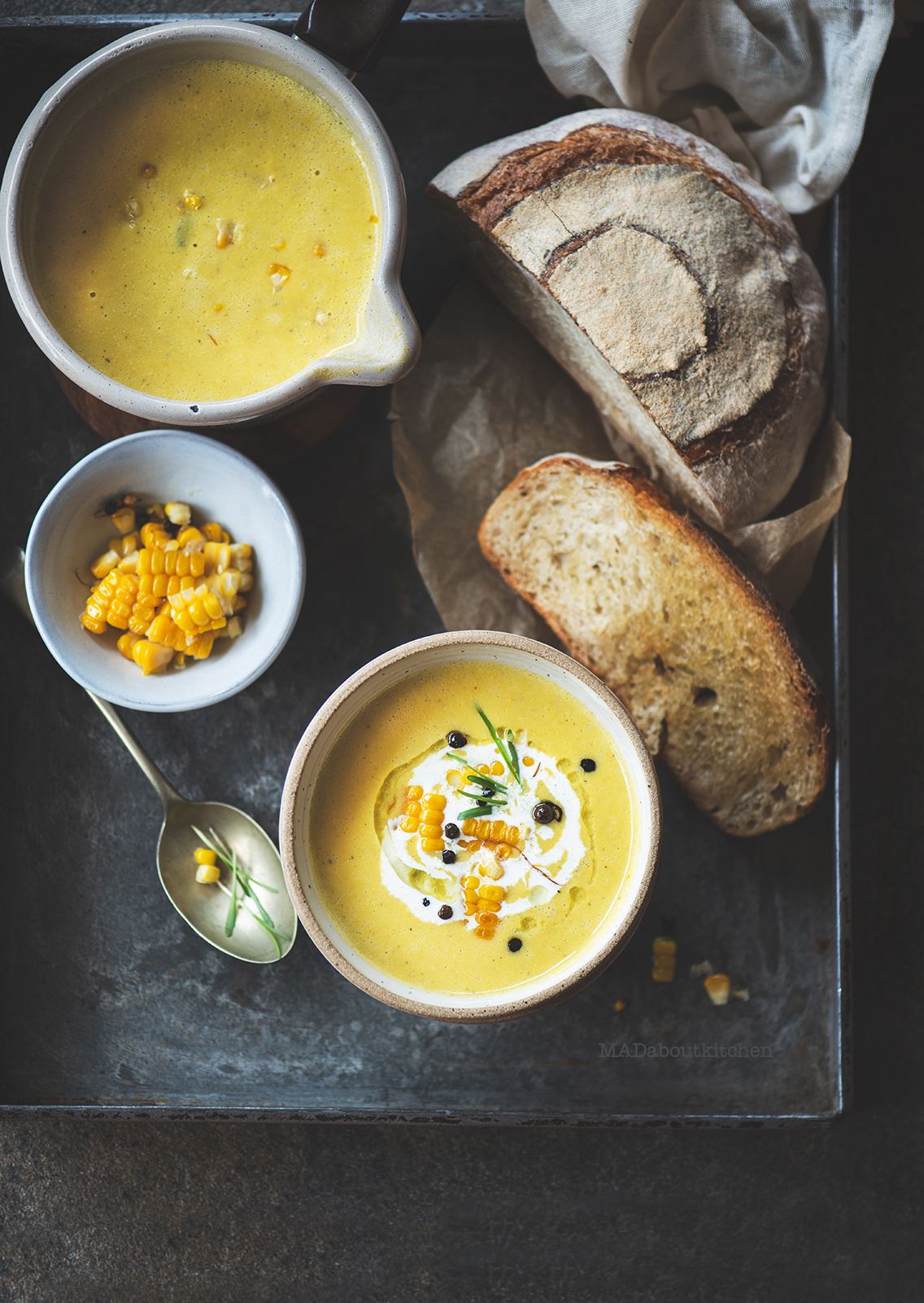 Corn soup is a creamy, light soup that is flavoured using garlic, rosemary and is served with a slice of crusty sourdough bread.