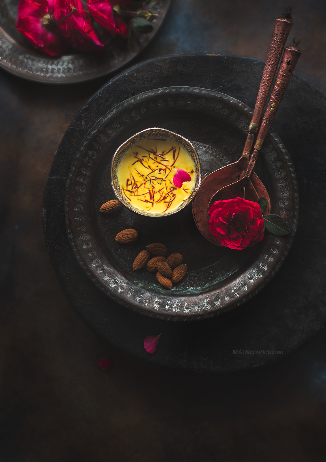 Rabdi, is an Indian dessert made by reducing whole milk to layers of cream. It is flavoured using saffron & is garnished with almonds & rose petals.