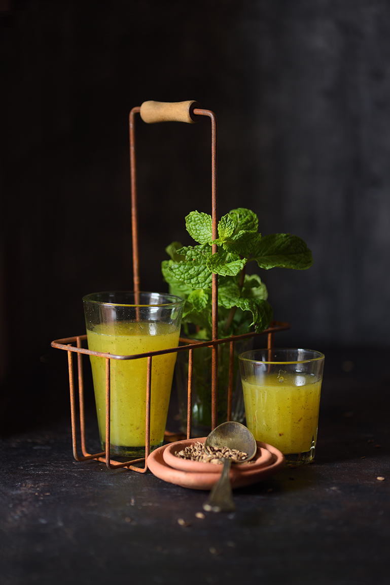 Aam Panna is a popular Indian cooler that is specially made during Summer. This is a tangy, sweet drink with a hint of mint and cumin. It is usually made using Totapuri Mango.