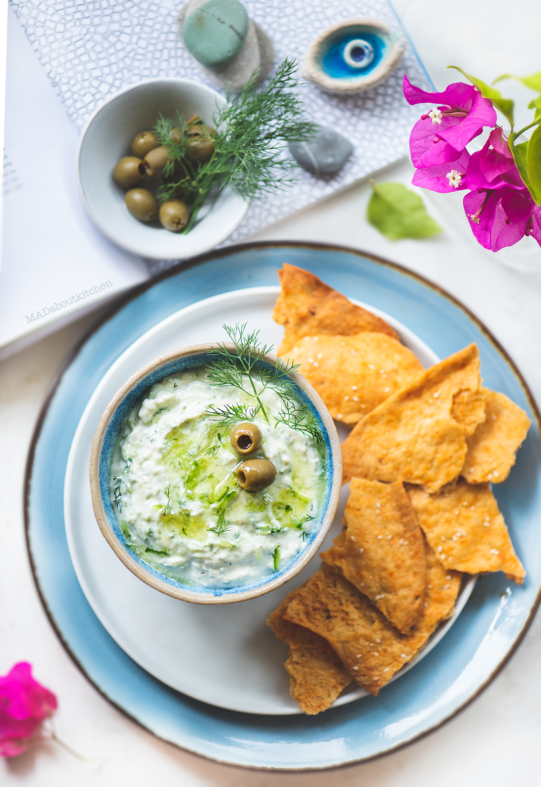 Tzatziki, the greek yogurt dip is a simple dip made using hung curd and is flavoured with garlic, dil leaves and drizzled with extra virgin olive oil.