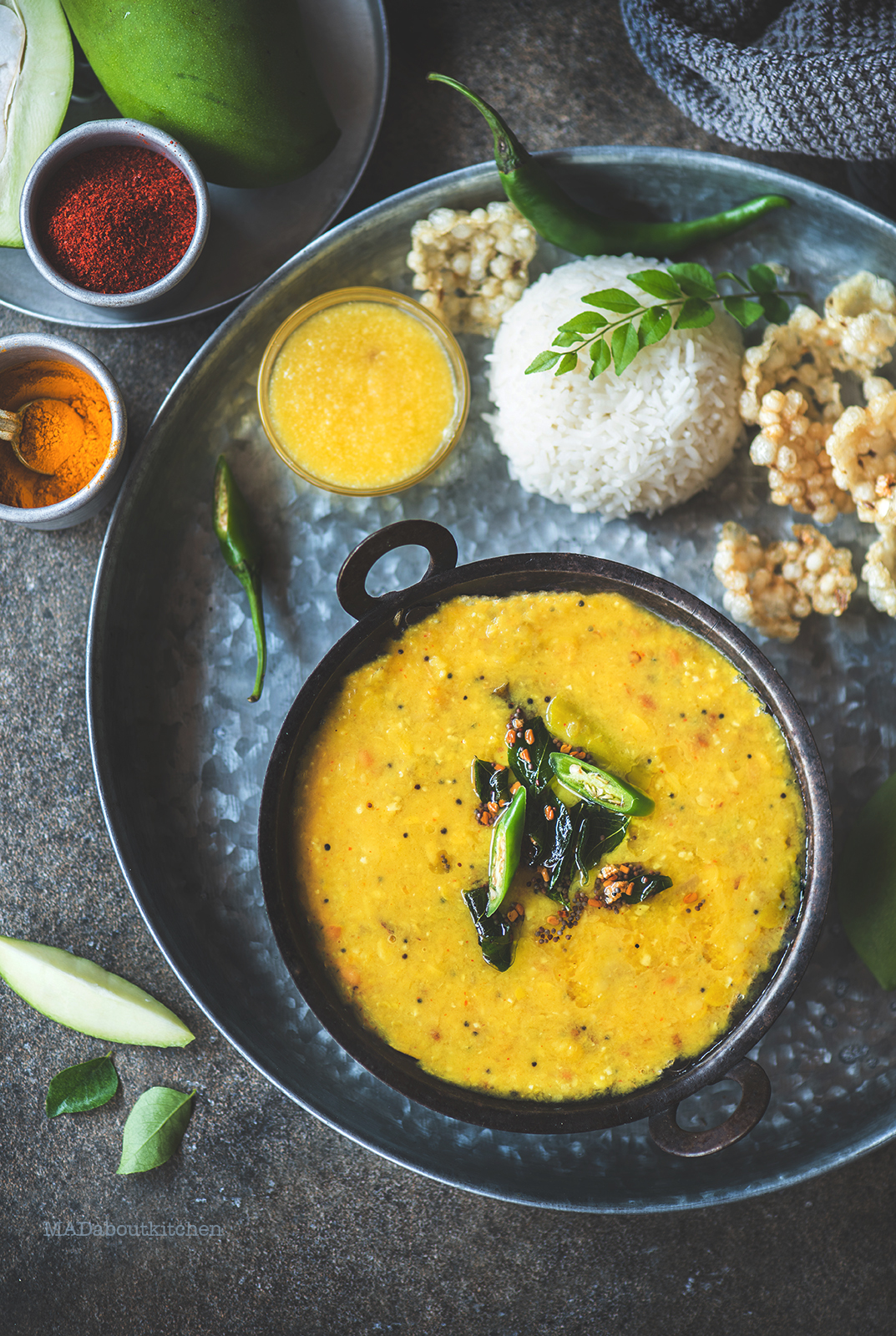 Mamidikaaya Pappu or the raw mango curry is a speciality from Andhra Pradesh. The sour ,spicy curry is served with steamed rice and ghee and some fryums.