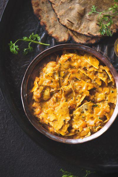 Dahi Papad ki Sabzi is a yogurt based curry made using Papadums.Dahi Papad ki Sabzi is well known curry from Rajasthan made using roasted papad.