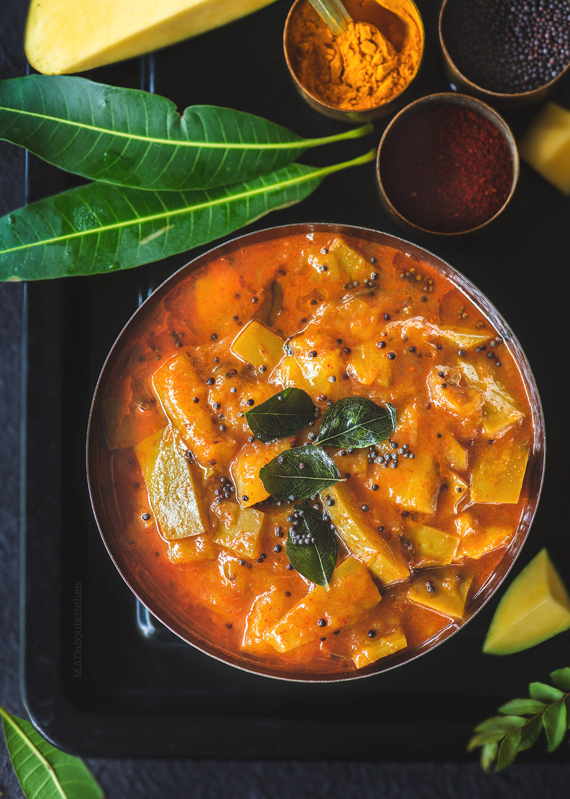 Paluvu or the raw mango curry is a lipsmacking, spicy, sweet, tangy raw & thick curry made using Tothapuri mango and can be served with almost everything.