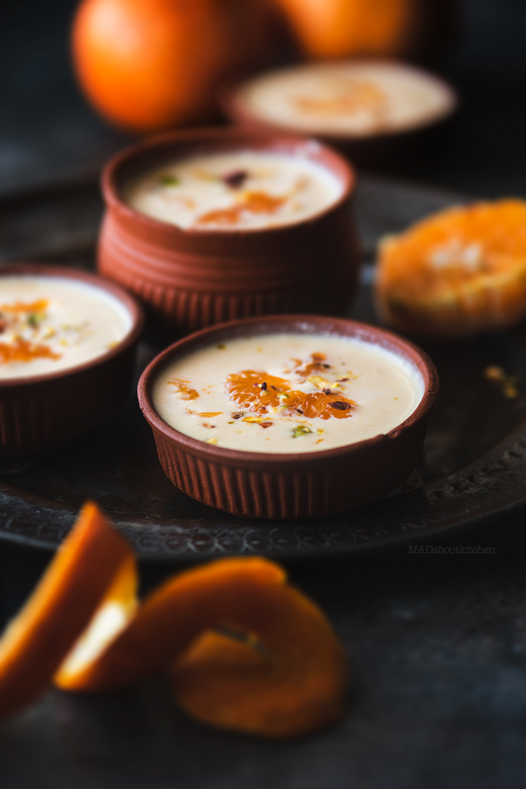 Kheer Komola is a Bengali Orange pudding, made by reducing milk and adding fresh Orange segments to it and is not only rich but also fresh.